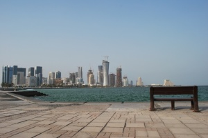 Empty Chair at Corniche with Doha skylines at the background
