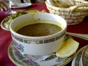 Lentil soup with Iranian spices (a basket of freshly baked bread at the background)