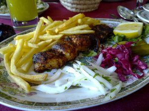 Joojhe Kabab Mashi - boneless chicken marinated in youghurt, Iranian-spiced and  cooked on charcoal (lemon juice with mint at the background)