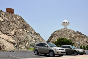 Huge Incense Burner and nearby watchtower in Mutrah - our cars on the foreground