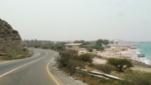 Fujairah - DIbba Road. A dualc arriageway ismingled to a single carriageway. This is a road near sandy beach/snoopy island