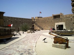 Dubai Museum - an outside area, displays cannon & traditional dhows