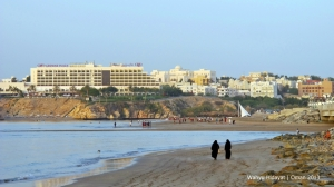 Qurm Beach and Crowne Plaza Hotel in the background