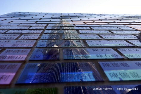 A reflection of Taipei 101 on the art wall