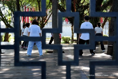 Elderly practicing a slow-motion Taichi exercise at CKS Memorial Hall Park