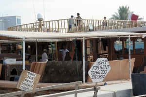 Rent a boat or dhow to go to Al Safliya Island