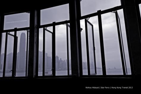 Siluet of windows from departure dock of Star Ferry at Tsim Sha Shui