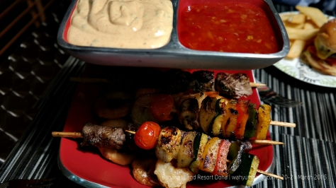 Surf and Turf - meat skewer, fried prawn, vegetable skewer and onion ring