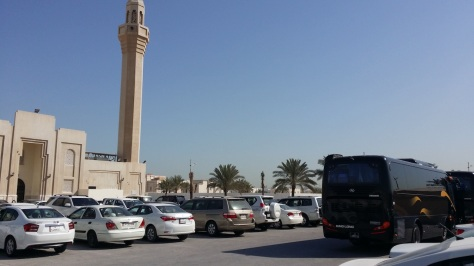 Shuttle Bus used to ferry applicants to Embassy compound in Onaiza. Seen here is Mosque of Maryam)